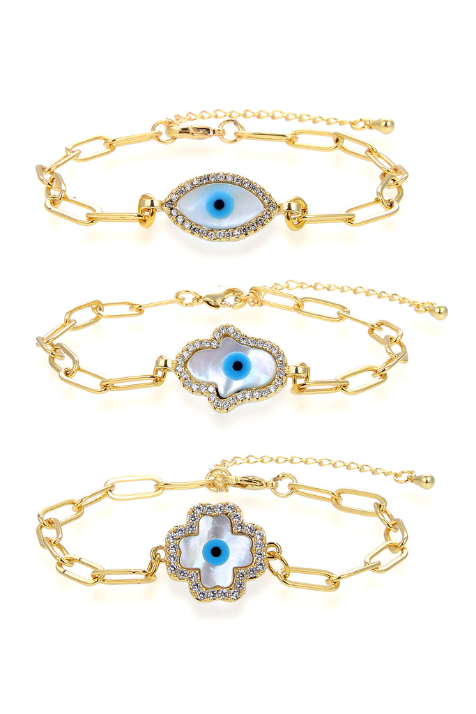 Set of 3 gold chain link bracelets. Each features evil eye motif. One housed in eye setting, one housed in hamsa hand setting and one in four leaf clover setting.