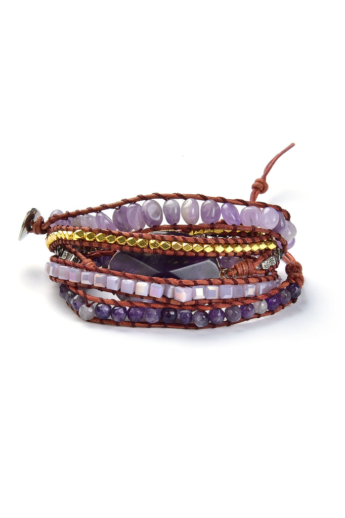 Amethyst thread wrap bracelet with layered bracelets of variety stone sizes and shapes.