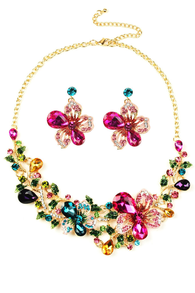 "Necklace and earring set. Approximately 14 inch gold Necklace with colorful pink and blue floral design. Earrings featured are approximately 2"" in size and feature light pink and magenta crystal petals."