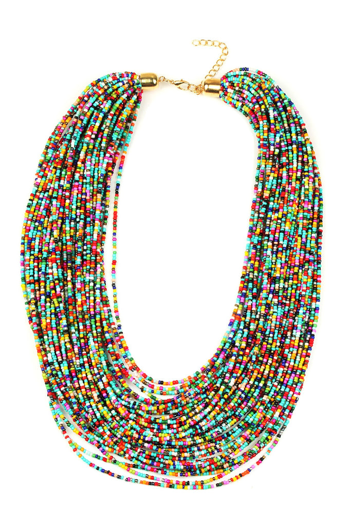 Large statement necklace composed of many layered chains. Chains feature a variety of small colored beads.