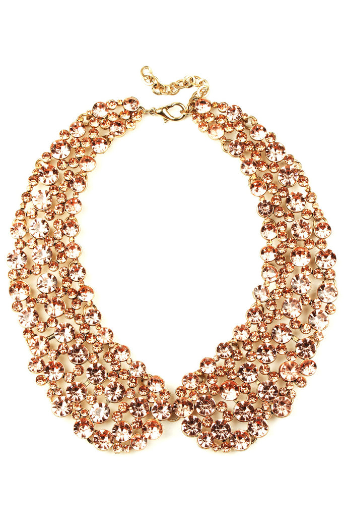 12 inch rose gold collar necklace with circular blush crystals arranged in collar pattern.