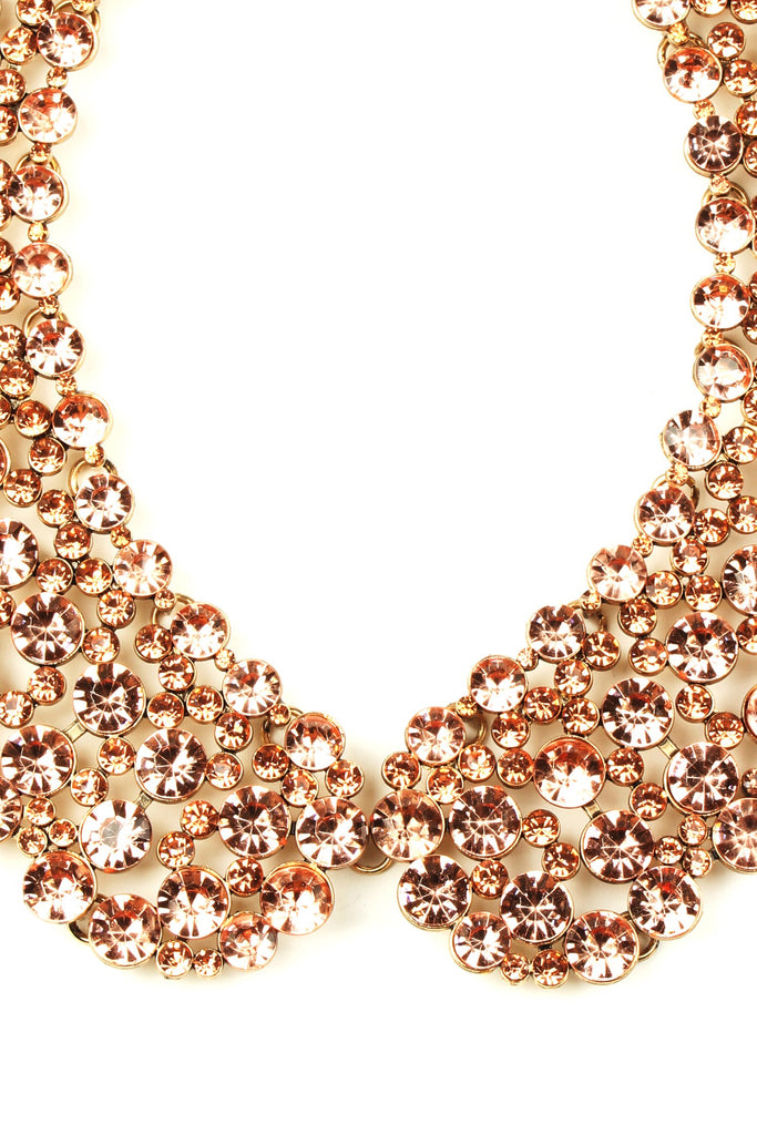 Close up of rose gold crystal collar necklace