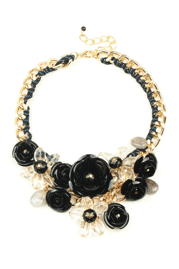 12 Inch gold statement necklace with chunky chain and array of black and gold metal flowers.
