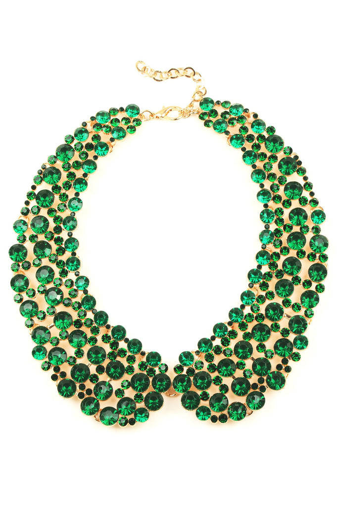 12 inch gold collar necklace with circular green crystals arranged in collar pattern.