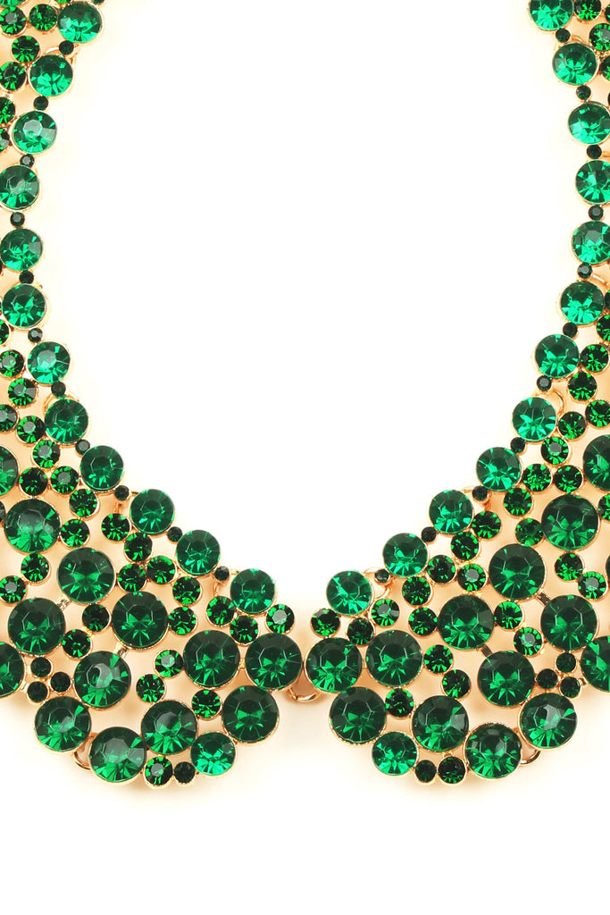 Close up view of circular green beads used on collar necklace.