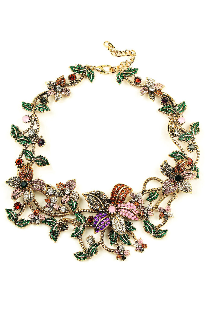 A floral garland collar necklace with crystal faceted pink flowers and green leaves
