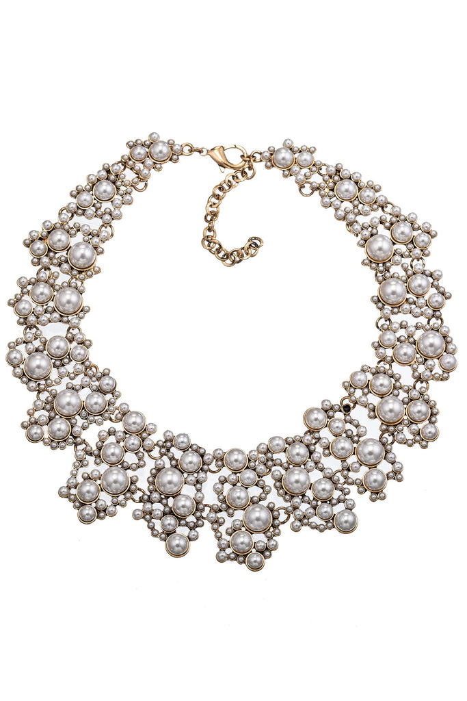 Large collar necklace with beaded pearl design. Features gold tone metal with collar arrangement of glass pearls. Also features lobster clasp closure.