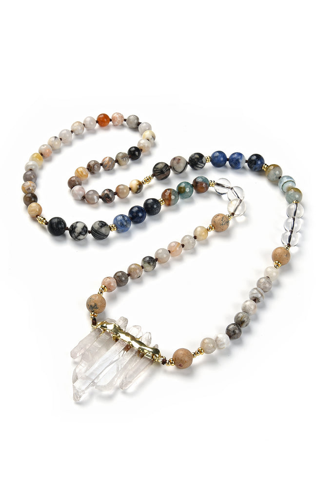 Complete view of 16 inch necklace with round agate beads of various colors and pendant composed of 5 white quartz crystals.