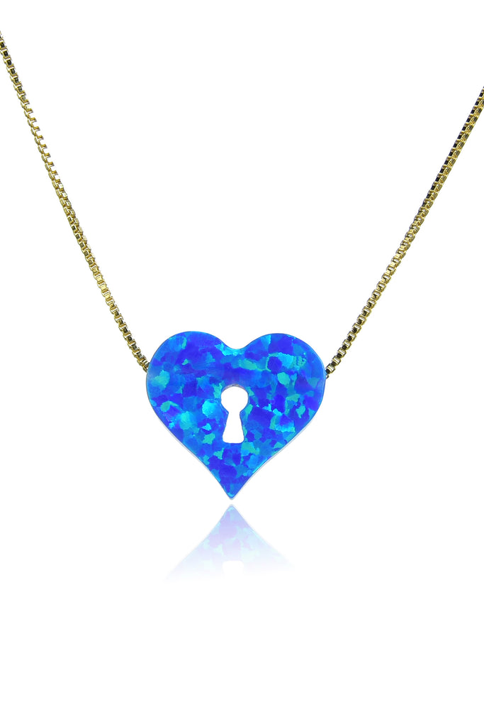 Thin gold chain necklace with blue heart pendant made of opal stone. Heart pendant features keyhole cutout.