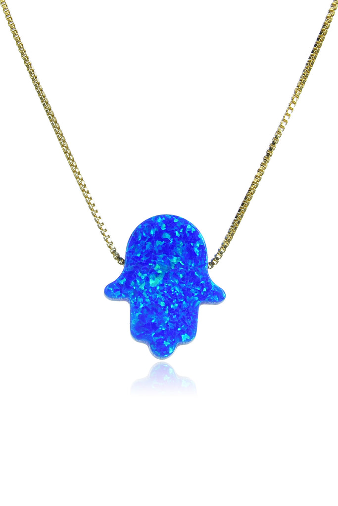 Small gold chain with shiny blue opal hamsa hand pendant.