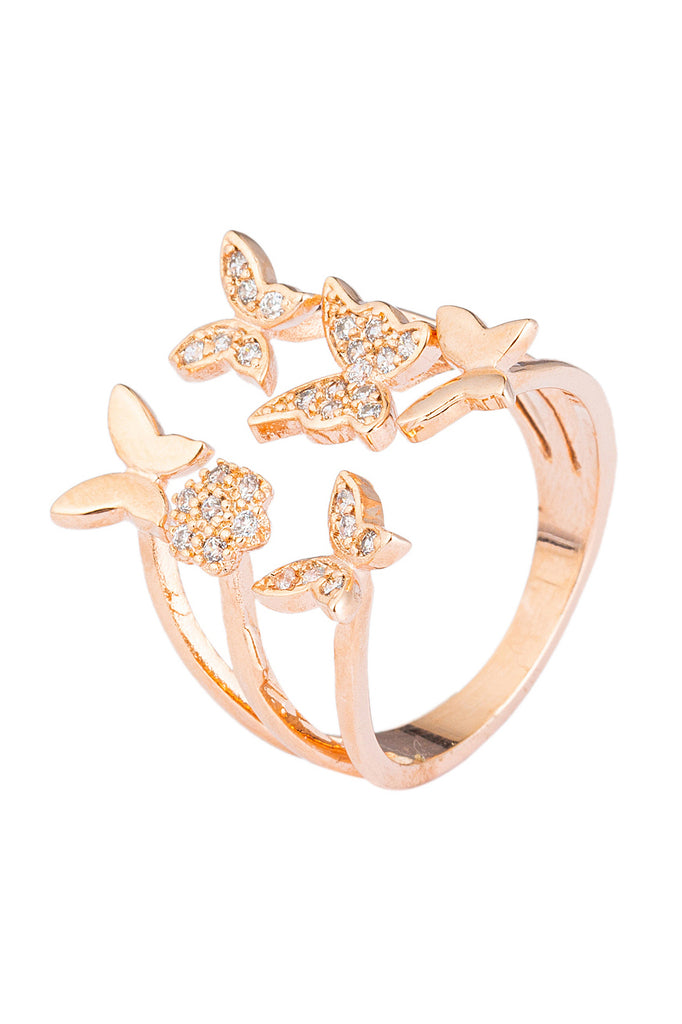 Fluttering butterflies ring studded with layered CZ crystals.
