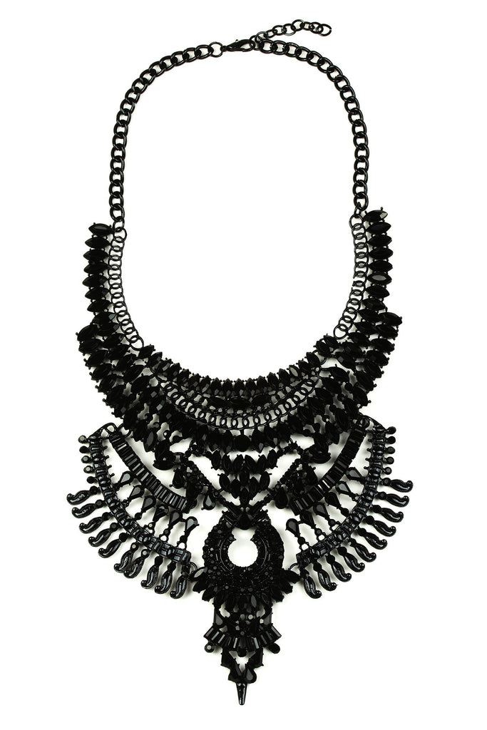 "A black metal gothic necklace approximately 16"" in length. The necklace features glass crystals arranged in an intricate layered pattern with a central Victorian style pendant."