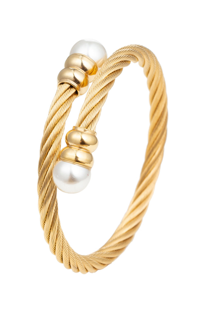 Gold wire cable titanium wrap cuff bracelet with glass pearls.