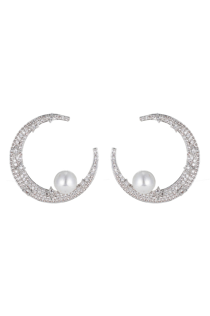 Silver crescent moon pearl earrings studded with CZ crystals.