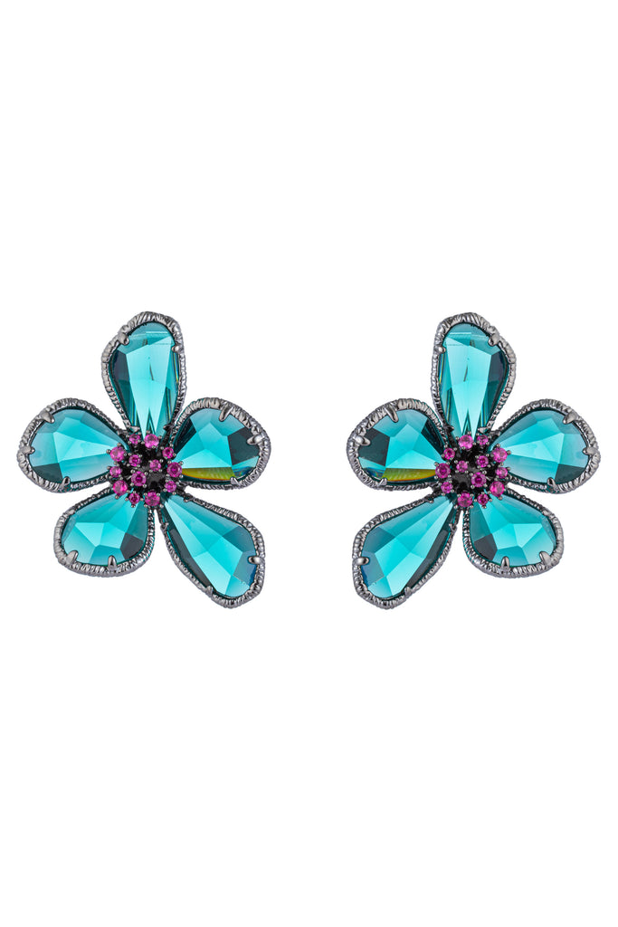 Pair of 1 inch blue and silver flower earrings. Earrings feature 5 teal cubic zirconia petals and studded purple cubic zirconia stone center.