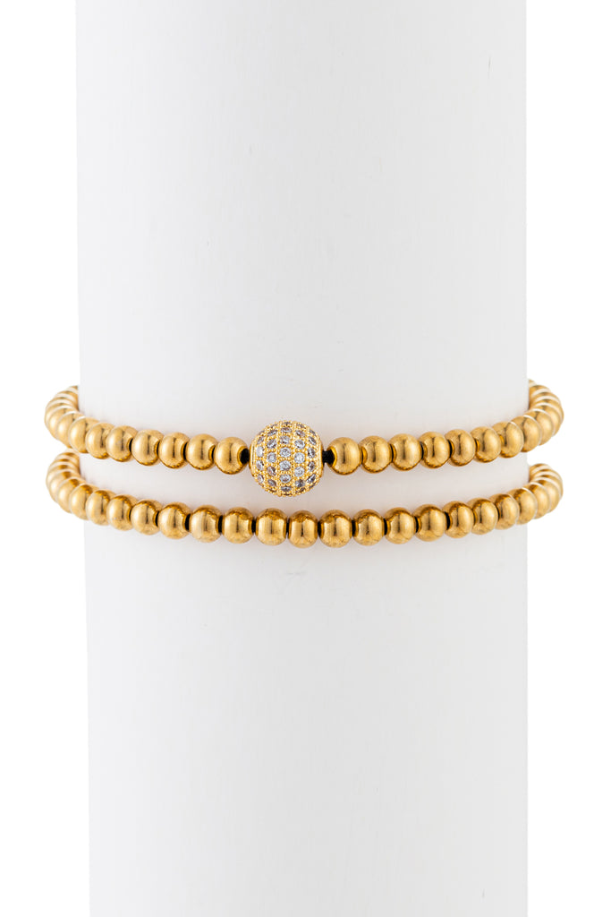Gold titanium beaded bracelet with brass CZ charm.