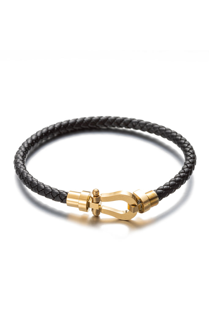 Leather 18k gold plated titanium bracelet.