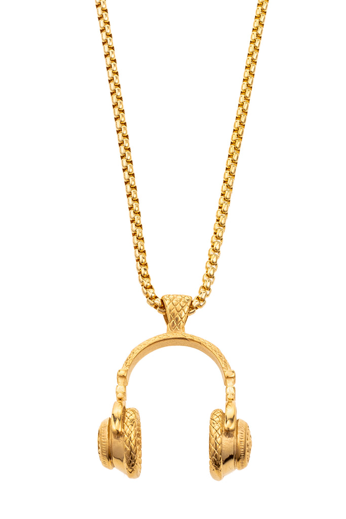 Small gold chain necklace with 1 inch pendant. Pendant is gold pair of old school headphones.
