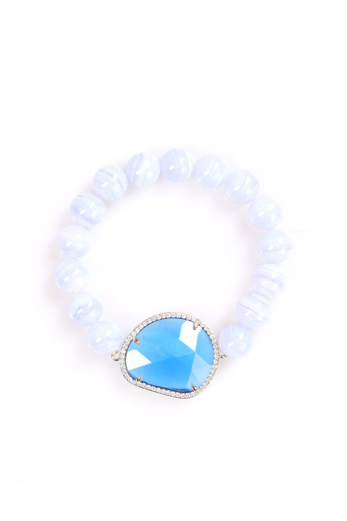 White agate beaded bracelet with blue crystal charm in cubic zirconia setting.