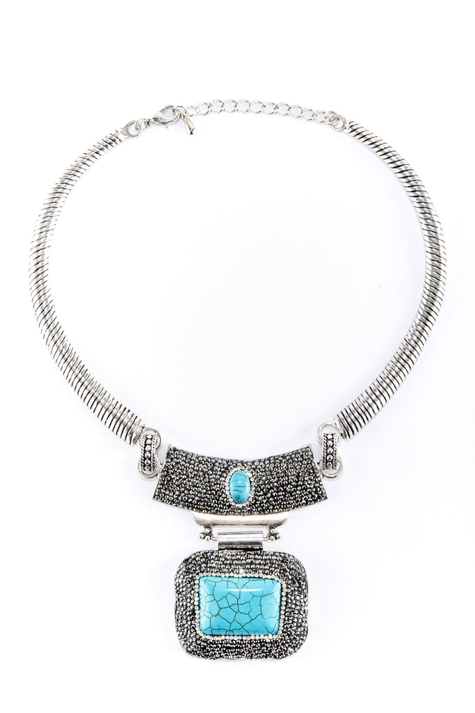 Silver wrapped chain necklace with double pendant design. Textured silver pendant with rounded square turquoise plate hanging.