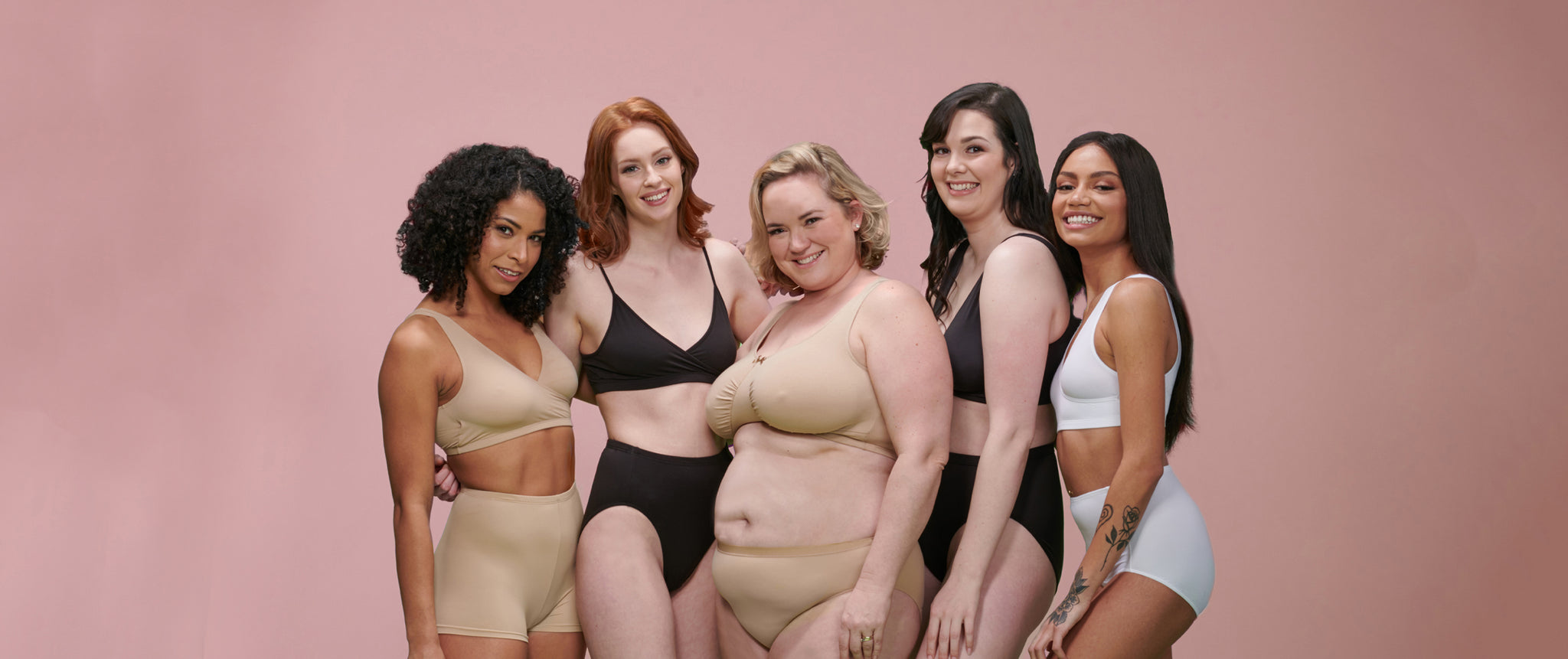 Group of diverse women standing together in various styles of underwear