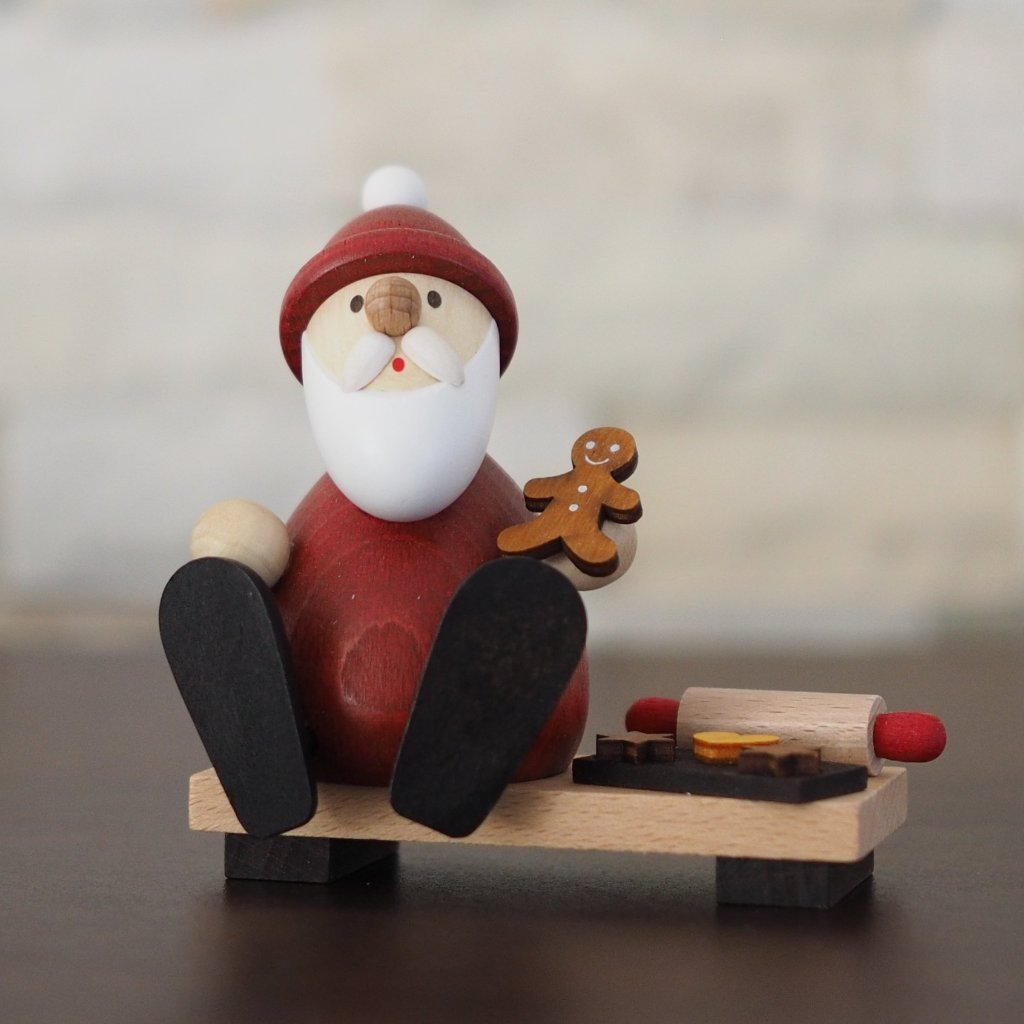 Weihnachtsmann Collectibles - Santa Eating Gingerbread