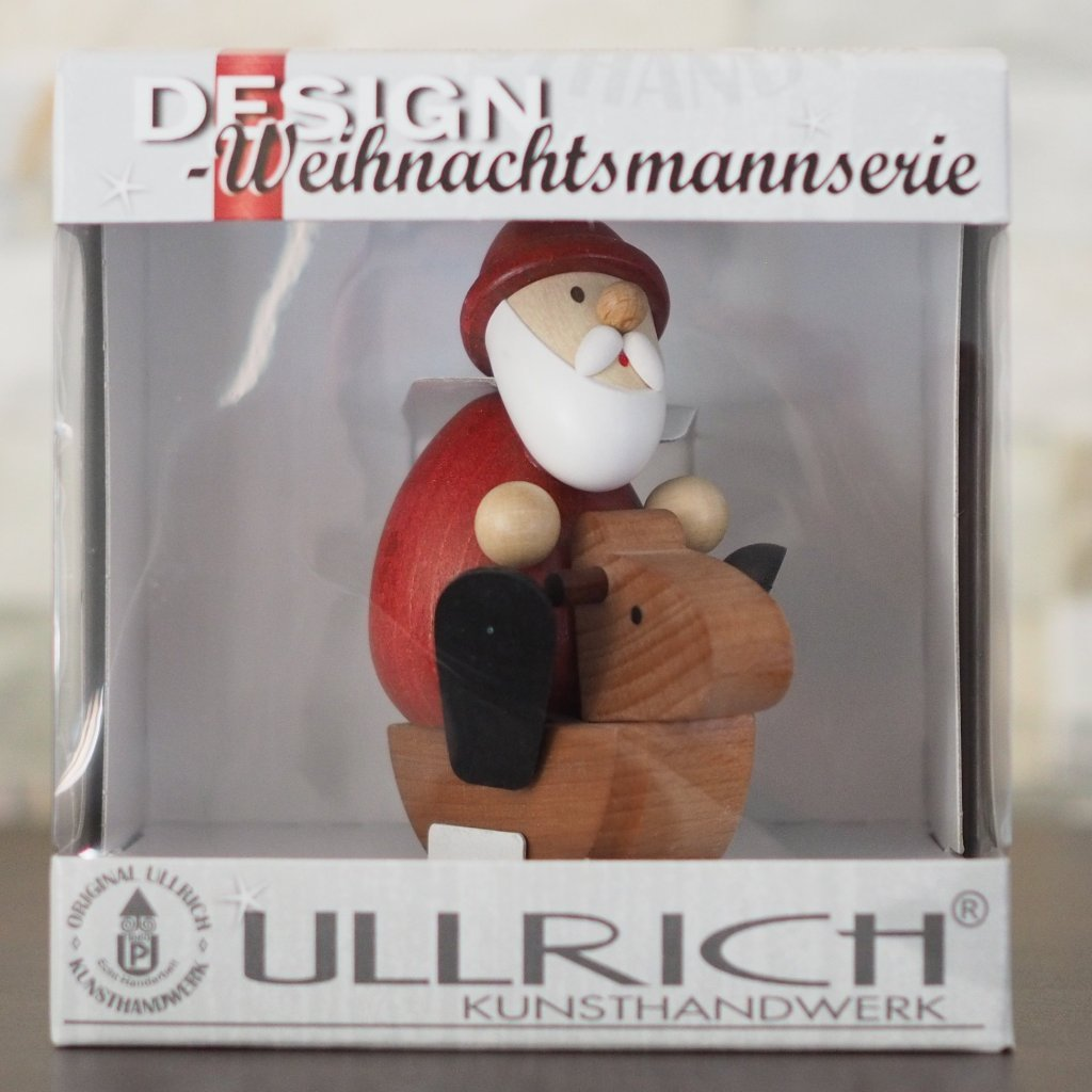 Weihnachtsmann Collectibles - Santa on Rocking Horse
