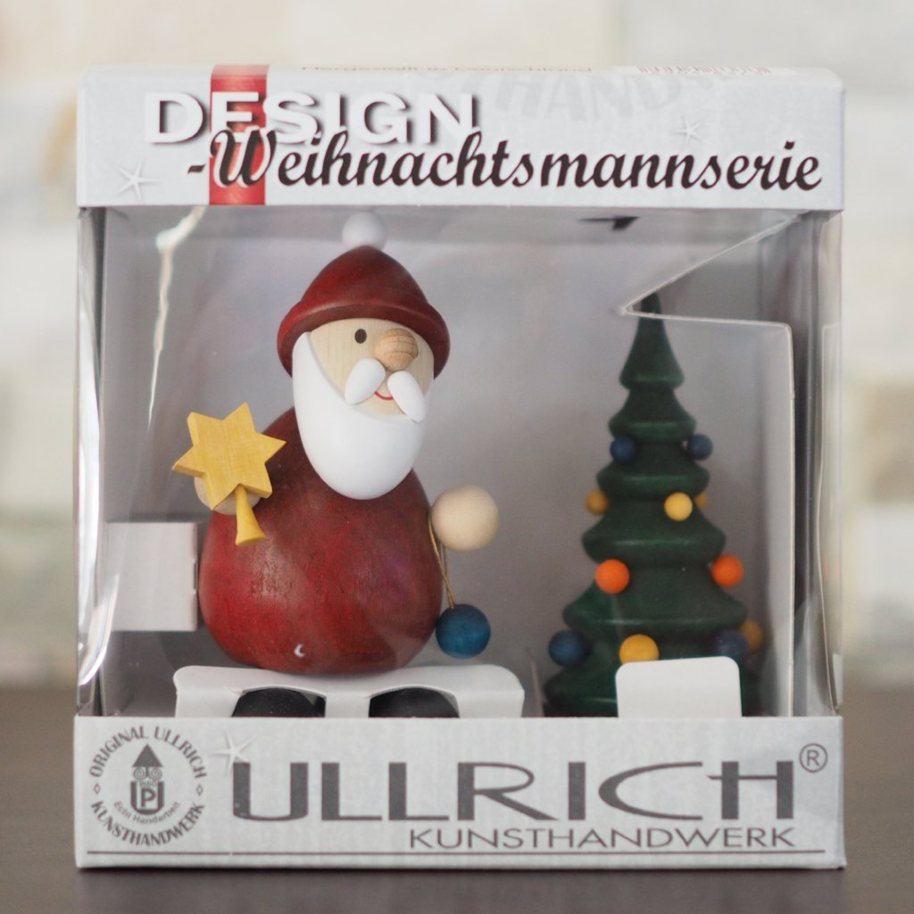 Weihnachtsmann Collectibles - Santa topping his Tree