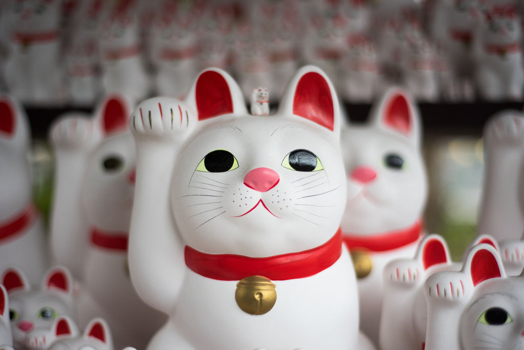 Who is the lucky cat Maneki Neko?
