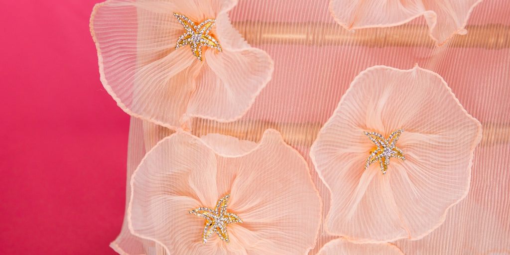 Totally Dazzled 2016 Lookbook Coral Beach closeup of Table Decor