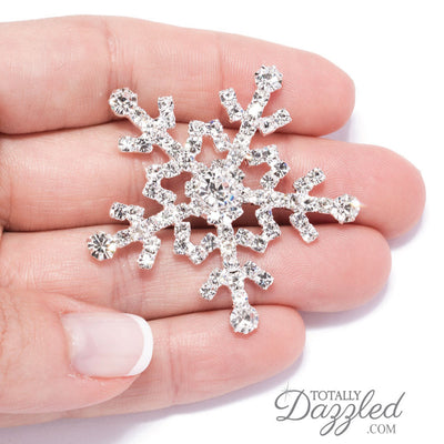 Snowflake Embellishments for Wedding Invitations in Hand