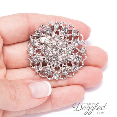 silver rhinestone flower brooch In Hand