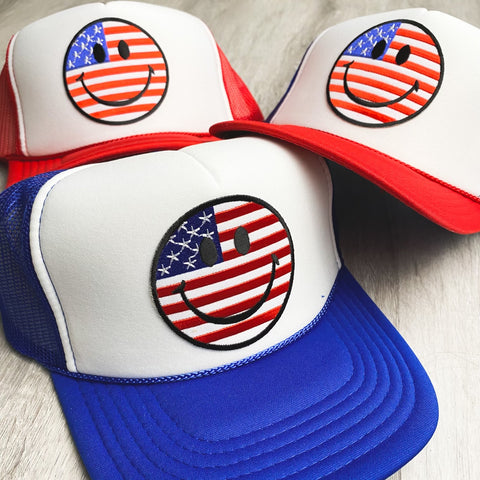 4th of July smiley face trucker hats from Lush Fashion Lounge women's boutique in Oklahoma City