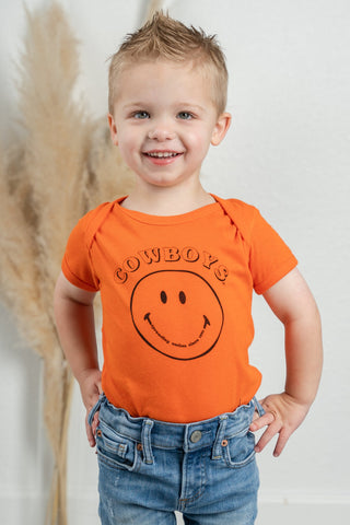 OSU kids onesie from Lush Fashion Lounge women's boutique in Oklahoma City