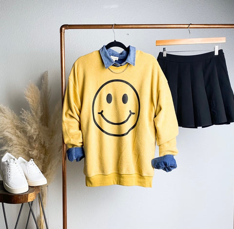 Smiley face sweatshirt from Lush Fashion Lounge women's boutique in Oklahoma City