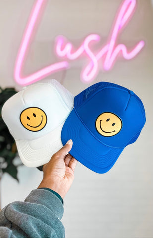 Smiley face trucker hats from Lush Fashion Lounge women's boutique in Oklahoma City