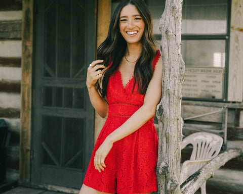 Red lace romper from Lush Fashion Lounge women's boutique in Oklahoma City