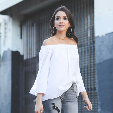 Off-Shoulder-Top-with-Ripped-Denims-with-statement-earrings