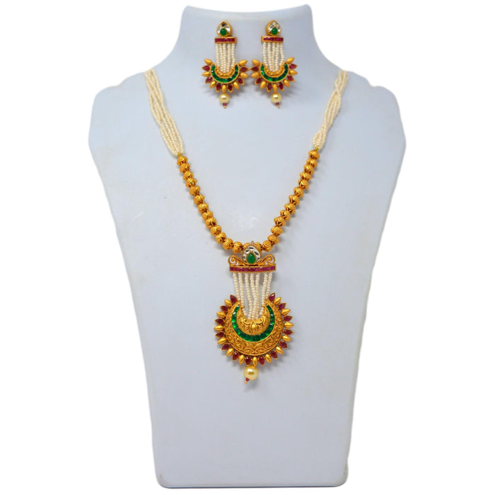 Temple & Red Green Stone Necklace Set On Mannequin