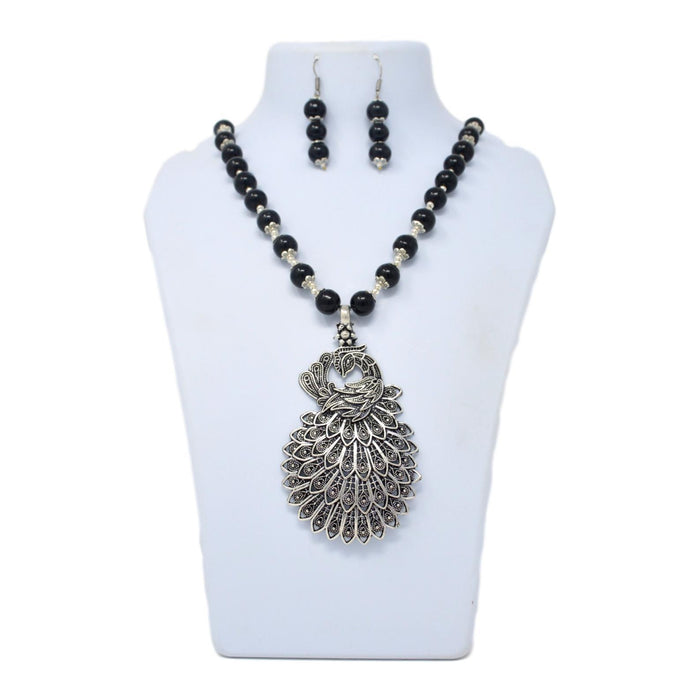 Black Mani Oxidised Peacock  Pendant Necklace Set On Mannequin