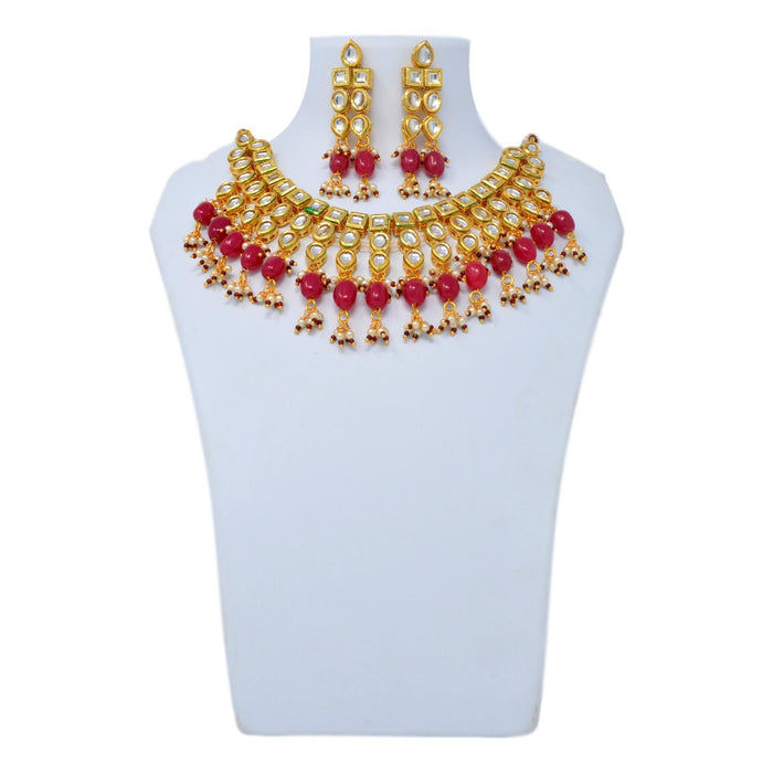 Red Stone and Moti Golden Kundan Necklace Set On Mannequin