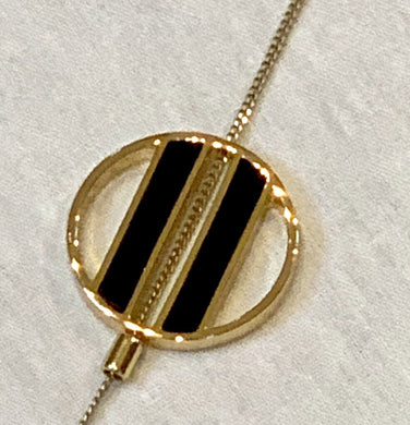 JENNY BIRD GOLD AND BLACK RESIN ADJUSTABLE LARIAT NECKLACE