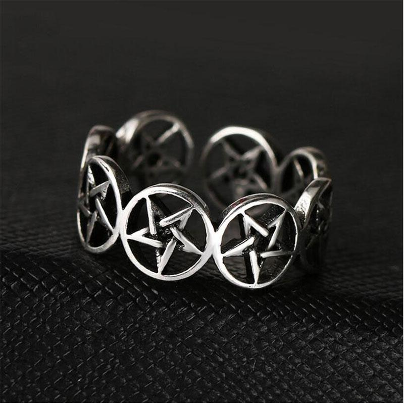 Adjustable Pentagram Ring. A silver band made of lots of small pentagrams, on a dark background. It looks very cult-like and mysterious