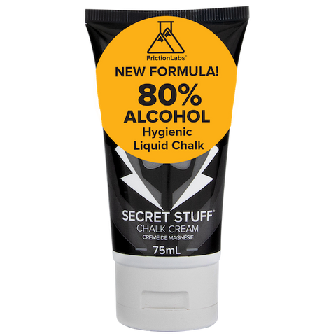 Black bottle of Friction Labs liquid chalk with yellow label advertising 80% alcohol