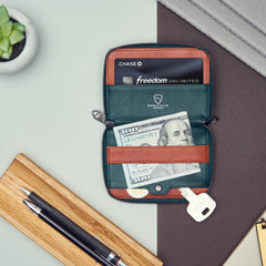 Vaultskin Notting Hill Zipper Wallet in Alpine Green with dollar note and key