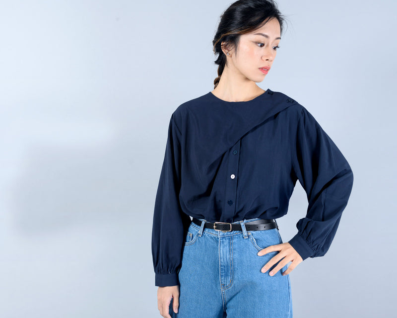 Navy blouse in asymmetric cut
