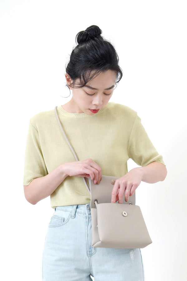 Grey leather cross body bag in thin strap
