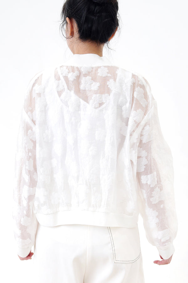 White bomber jacket in sheer floral pattern