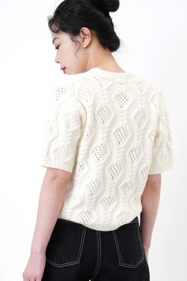 Cream knit top in 3D twist pattern