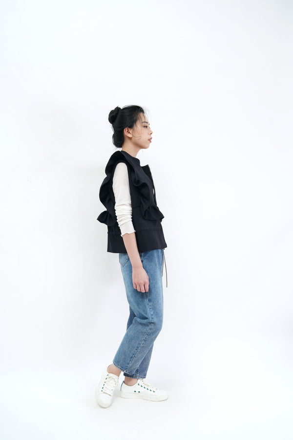 Black vest outer in ruffle detail